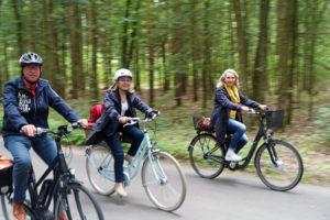 Drei Fahrradfahrer